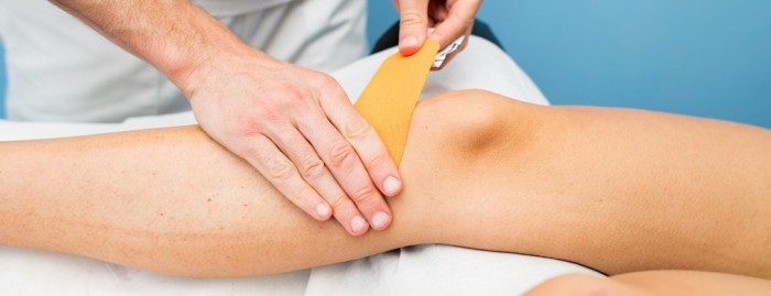 Taping and exercise for knee pain