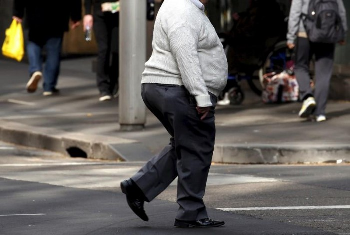 Do obese adults walk differently in shoes vs. barefoot?